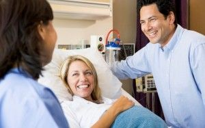Doctor Talking To Pregnant Woman And Her Husband